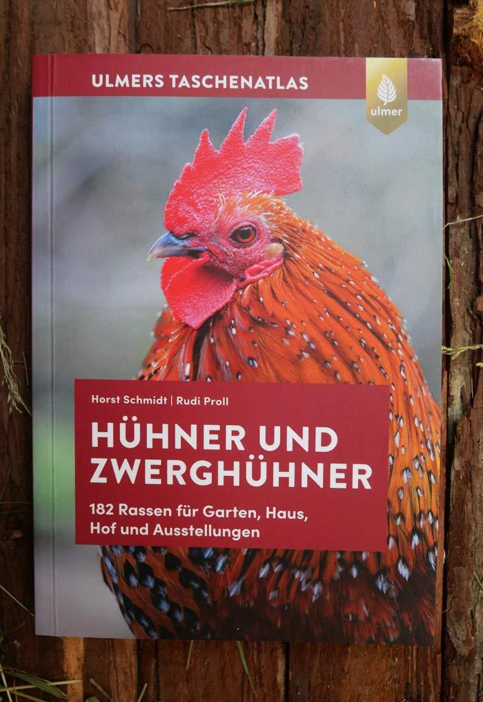 Hühner und Zwerghühner Ulmers Taschenatlas Cover vor braunem Hintergrund